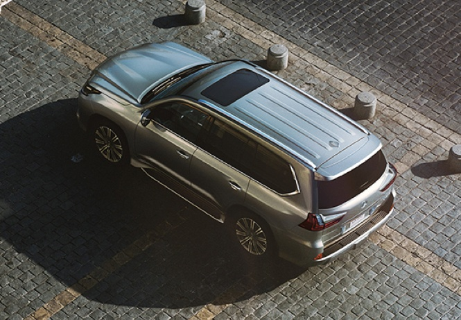 Lexus LX 570 overhead view parked on a brick road