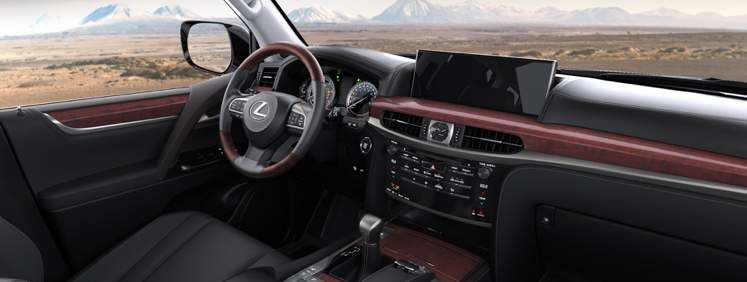 Front interior of Lexus 570 with mountains in background