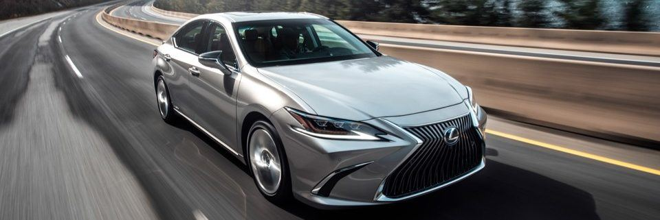 2021 Lexus ES in atomic silver driving on a curving highway
