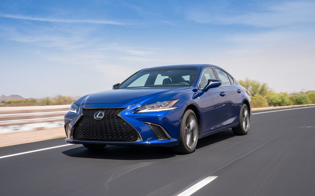 2021 Lexus ES 350 F Sport in Ultrasonic blue driving on a paved country road